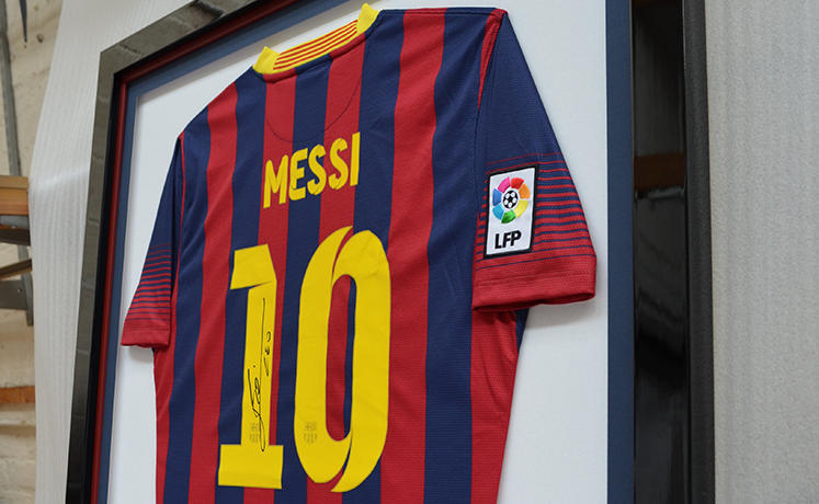 Lionel Messi framed football shirt